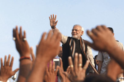 Narendra Modi greets supporters in Ahmedabad, 2013