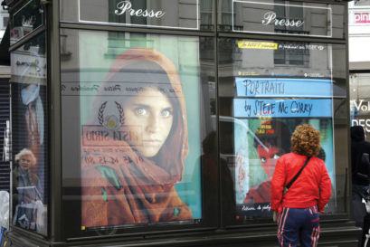 Works by McCurry displayed at a news kiosk in Paris