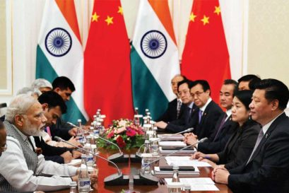 Narendra Modi heads the Indian delegation in talks with China led by its President Xi Jinping  at the SCO Summit in Tashkent on 23 June