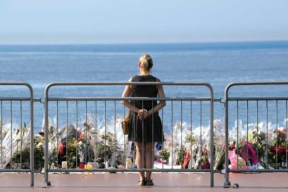 A woman at a makeshift memorial after the Nice attack