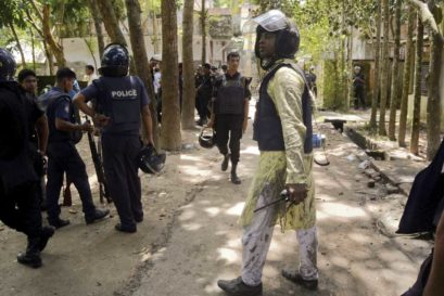 Police outside the blast site in Kishoreganj, Bangladesh, which took place on Eid, 7 July