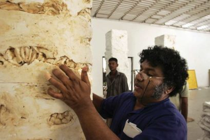 Chandraguptha Thenuwara adds final touches to his art at a gallery in Colombo