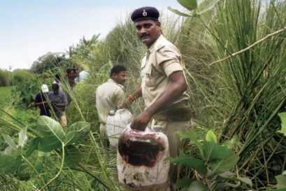 Policemen recover illicit liquor from a field near Gopalganj