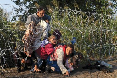 Syrian refugees attempt to enter Hungary through its border with Serbia