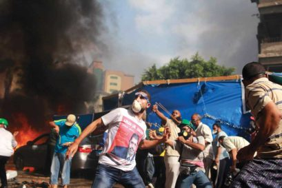 Supporters of Egypt's ousted President Mohamed Morsi clash with security forces in Cairo, 2013