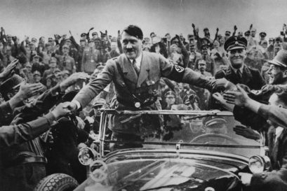 Adolf Hitler (1889 - 1945), chancellor of Germany, is welcomed by supporters at Nuremberg