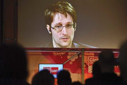 Snowden live on screen from Russia at a trade fair in Germany