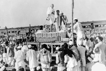 Gandhi addresses a crowd at a railway platform in Assam, 1946