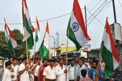 Ghanshyamdas Gupta (centre, with flag), head of the VHP in Bisauli, leads a procession calling for Babloo's arrest