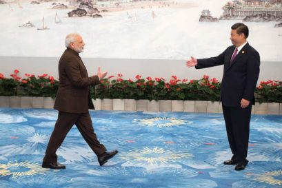 Chinese President Xi Jinping welcomes Prime Minister Narendra Modi at a BRICS banquet in Xiamen on September 4