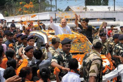 Amit Shah greets supporters at the Agartala airport in Tripura
