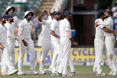 Virat Kohli (R) hugs his teammate Mohammed Shami after winning the fourth day of the third Test match between South Africa and India at Wanderers cricket ground in Johannesburg on January 27, 2018