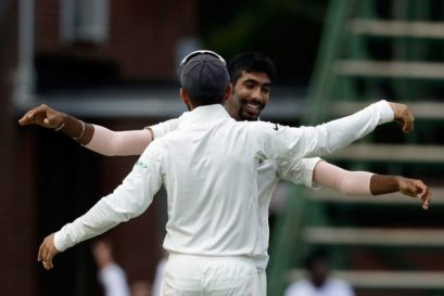 Jasprit Bumrah (facing camera) celebrates with captain Virat Kohli after dismissing South Africa's batsman Lungi Ngidi
