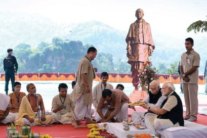 Narendra Modi and LK Advani at an inaugural ritual on the site in Gujarat of the proposed Statue of Unity with a replica of it in the background, October 2013