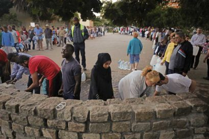 Capetonians queue up for water at a natural spring in Newlands