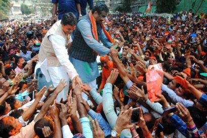 BJP National General Secretary Ram Madhav and Tripura BJP chief Biplab Kumar Deb greet the supporters after party's victory in Tripura Assembly elections