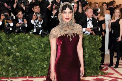 Priyanka Chopra in a maroon and gold Ralph Lauren gown