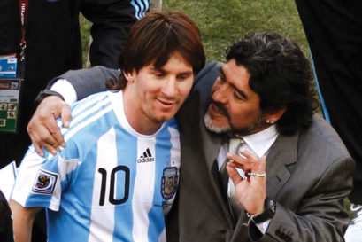 Messi with Maradona, who was Argentina's coach then, at Johannesburg 2010