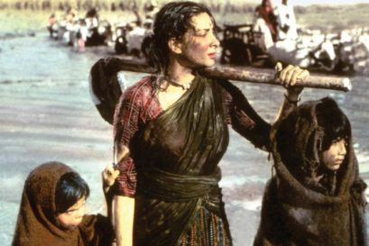 Nargis struggles to save her village from a flood in Mother India