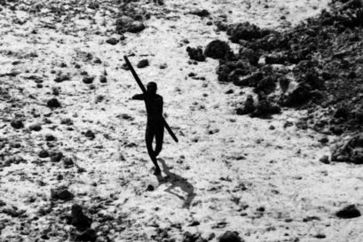 A tribal on North Sentinel Island photographed from an Indian coast guard helicopter after the Tsunami in 2004