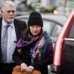 Huawei chief financial officer Meng Wanzhou arrives at a parole office with a security guard in Vancouveron 12 December, 2018