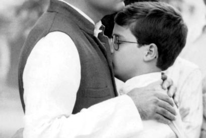 Rahul hugging his father at his grandmother's cremation