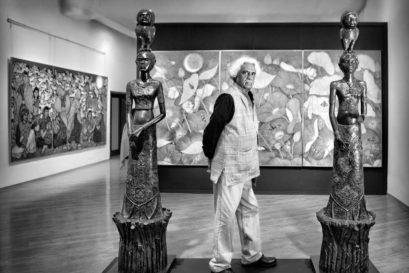 A Ramachandran with his paintings