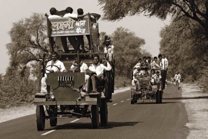 A makeshift band wagon trundles along a rural road