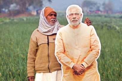 A farmer poses with a cutout of Prime Minister Narendra Modi in Dadri, Uttar Pradesh