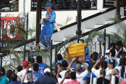 Fans greet Dhoni as he heads out to bat against Australia in India's last ODI series before the World Cup